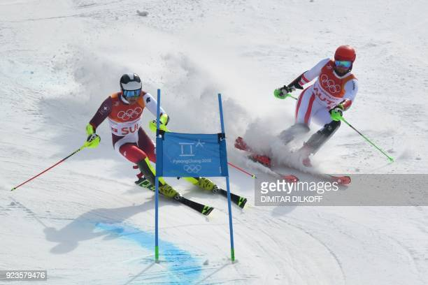 Switzerland's Daniel Yule and Austria's Marco Schwarz compete in the Alpine Skiing Team Event big final at the Jeongseon Alpine Center during the...