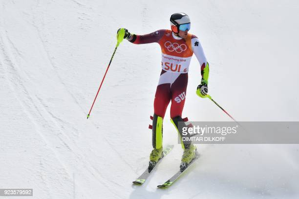 Switzerland's Daniel Yule reacts as he crosses the finishline in the Alpine Skiing Team Event big final at the Jeongseon Alpine Center during the...