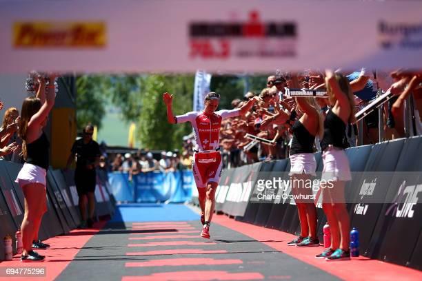 Switzerland's Daniela Ryf celebrates winning the women's race during Ironman 703 RapperswilJona on June 11 2017 in Rapperswil Switzerland