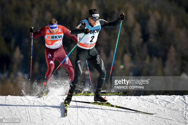 Switzerland's Dario Cologna and Russian Sergey Ustiugov competes in the Men's 15 km pursuit free during the cross country FIS World cup Tour de Ski...