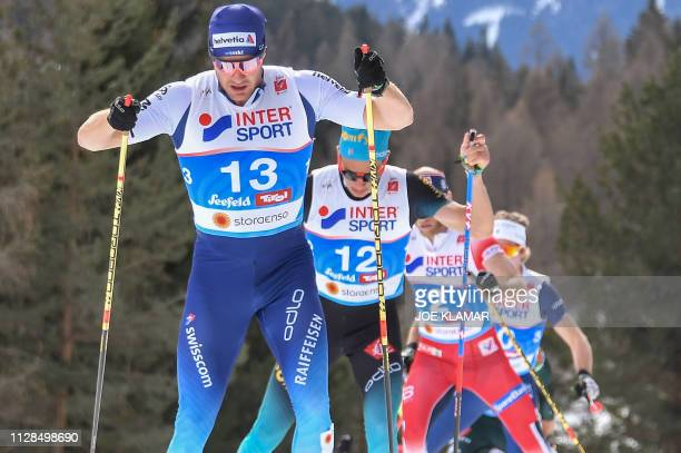 Switzerland's Dario Cologna leads a pack during the Cross-Country Men 50km Mass Start Free event at the FIS Nordic World Ski Championships on March...
