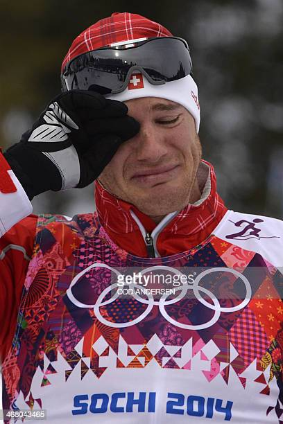 Switzerland's Dario Cologna wipes away tears after winning gold in the Men's CrossCountry Skiing 15km 15km Skiathlon at the Laura CrossCountry Ski...