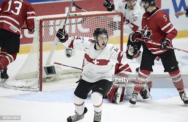 Switzerland's Dario Meyer celebrates his 20 goal in front of Canada's goalie Mackenzie Blackwood during the 2016 IIHF World Junior U20 Ice Hockey...