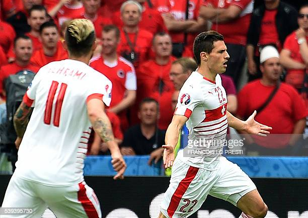 Switzerland's defender Fabian Schaer celebrates with Switzerland's midfielder Valon Behrami after scoring a goal during the Euro 2016 group A...