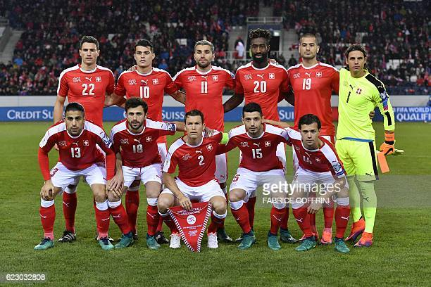 Switzerland's defender Fabian Schaer midfielder Granit Xhaka midfielder Valon Behrami defender Johan Djourou forward Eren Derdiyok goalkeeper Yann...