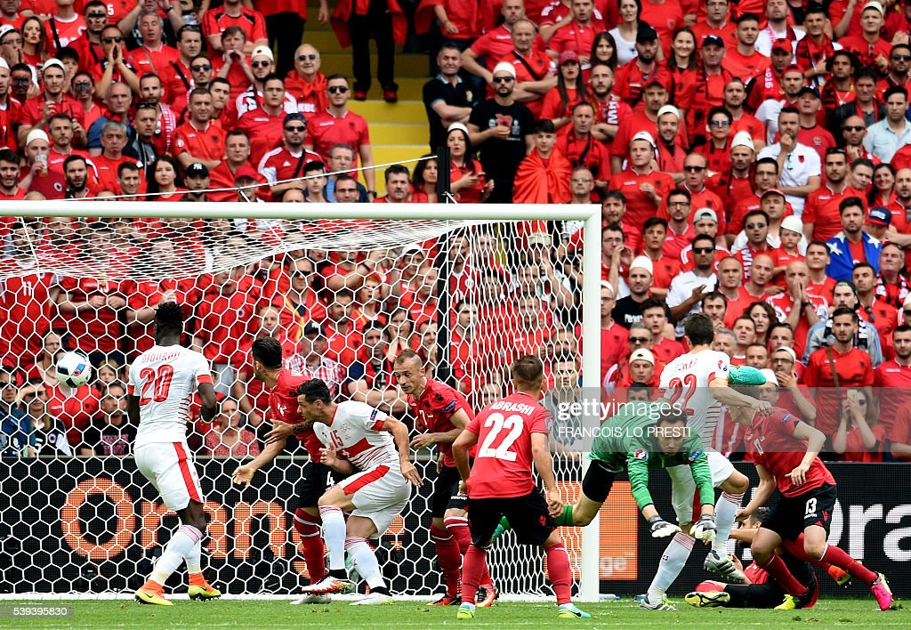 Switzerland's defender Fabian Schaer (2nd-R) scores a header during the Euro 2016 group A football match between Albania and Switzerland at the Bollaert-Delelis Stadium in Lens on June 11, 2016. / AFP / FRANCOIS