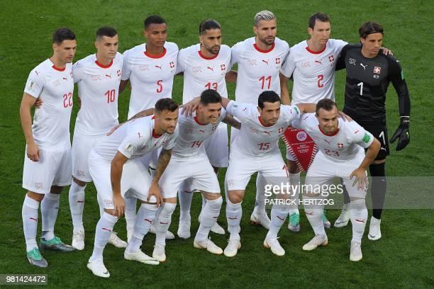Switzerland's defender Fabian Schaer Switzerland's midfielder Granit Xhaka Switzerland's defender Manuel Akanji Switzerland's defender Ricardo...