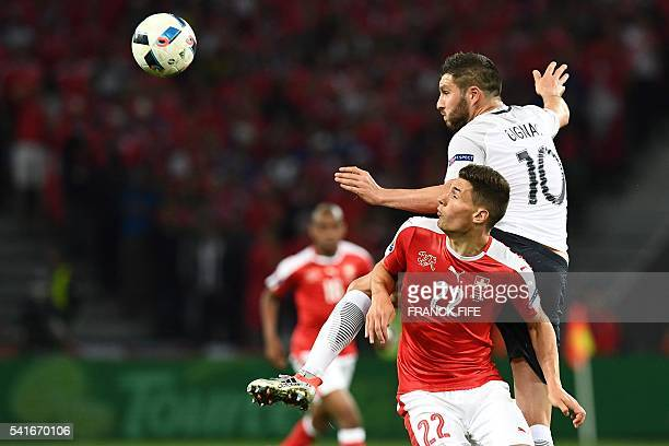 Switzerland's defender Fabian Schaer vies for the ball agaimst France's forward AndrePierre Gignac during the Euro 2016 group A football match...