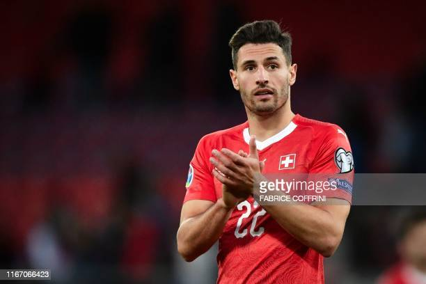 Switzerland's defender Fabian Schär applauds at the end of the Euro 2020 qualifying football match between Switzerland and Gibraltar, at the Stade...