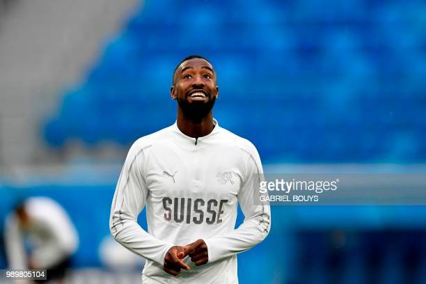 Switzerland's defender Johan Djourou looks on during a training session at the Saint Petersburg Stadium in Saint Petersburg on July 2 2018 on the eve...