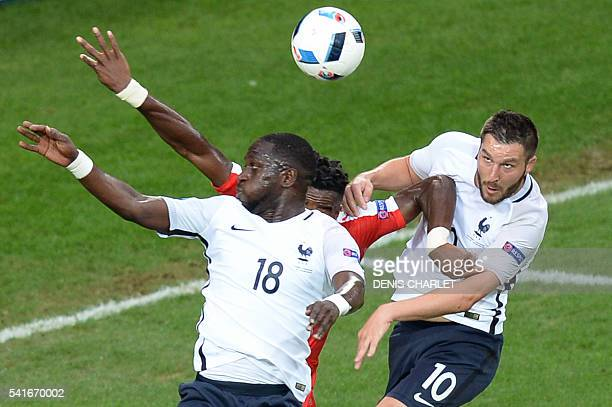 Switzerland's defender Johan Djourou vies with France's midfielder Moussa Sissoko and France's forward AndrePierre Gignac during the Euro 2016 group...