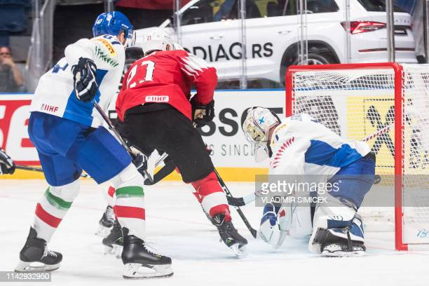 Switzerlands defender Kevin Fiala scores against Italy's goalkeeper Andreas Bernard during the IIHF Men's Ice Hockey World Championships Group B...