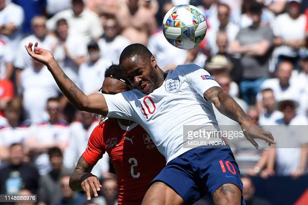 Switzerland's defender Kevin Mbabu heads the ball with England's forward Raheem Sterling during the UEFA Nations League third place playoff football...