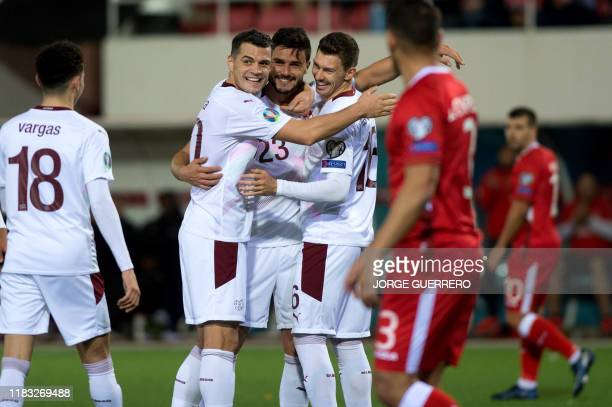 Switzerland's defender Loris Benito celebrates with his teammates after scoring a goal during the Euro 2020 Group D qualification football match...