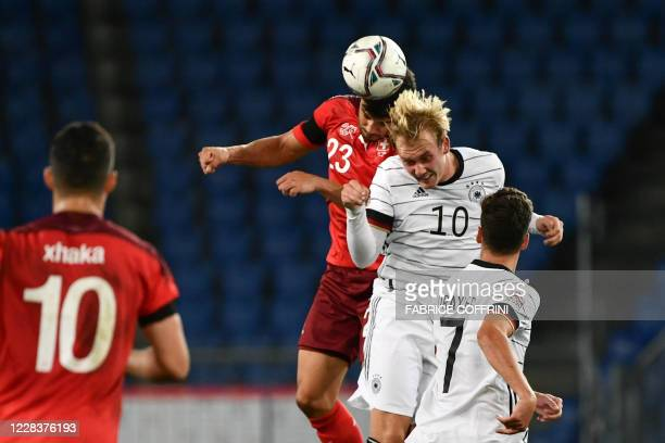 Switzerland's defender Loris Benito Souto fights for the ball with Germany's midfielder Julian Brandt during the UEFA Nations League league A day 2...