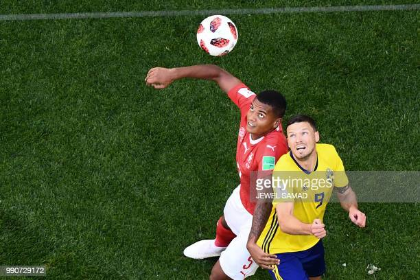Switzerland's defender Manuel Akanji fights for the ball with Sweden's forward Marcus Berg during the Russia 2018 World Cup round of 16 football...