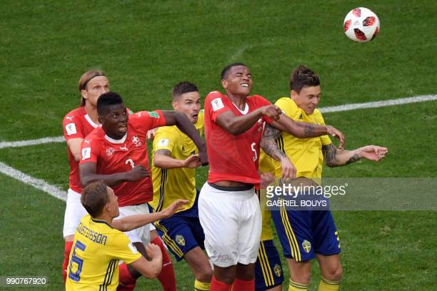 TOPSHOT Switzerland's defender Manuel Akanji heads the ball during the Russia 2018 World Cup round of 16 football match between Sweden and...