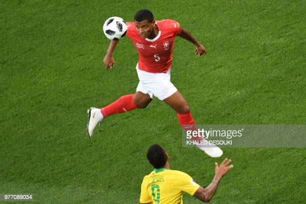 Switzerland's defender Manuel Akanji jumps for the ball during the Russia 2018 World Cup Group E football match between Brazil and Switzerland at the...