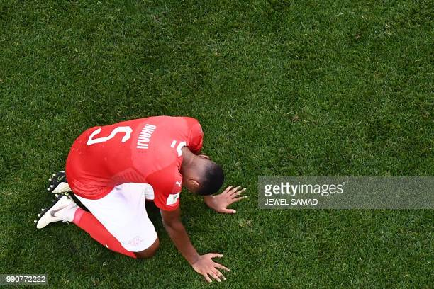 TOPSHOT Switzerland's defender Manuel Akanji looks dejected at the end of the Russia 2018 World Cup round of 16 football match between Sweden and...