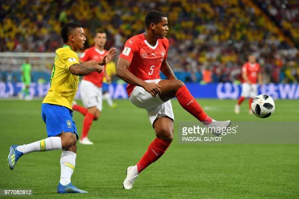 Switzerland's defender Manuel Akanji passes the ball during the Russia 2018 World Cup Group E football match between Brazil and Switzerland at the...