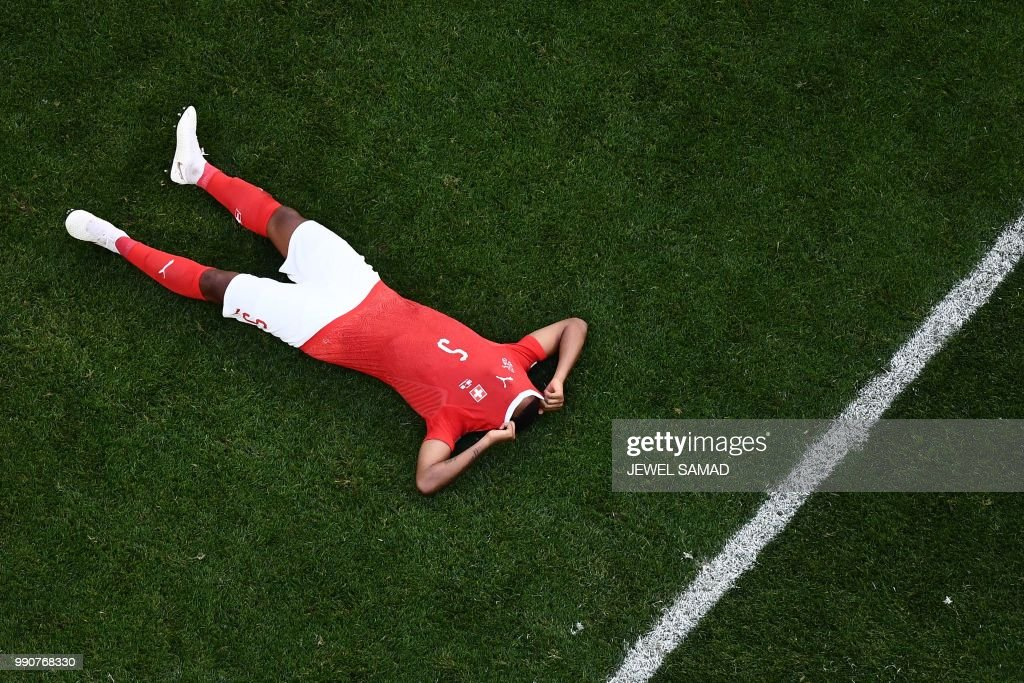 TOPSHOT - Switzerland's defender Manuel Akanji reacts at the end of the Russia 2018 World Cup round of 16 football match between Sweden and Switzerland at the Saint Petersburg Stadium in Saint Petersburg on July 3, 2018. Sweden won 1-0. (Photo by Jewel SAMAD / AFP) / RESTRICTED