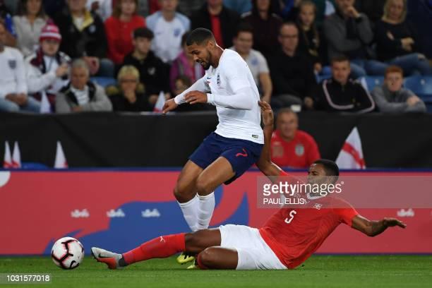 Switzerland's defender Manuel Akanji tackles England's midfielder Ruben LoftusCheek during a friendly international football match between England...