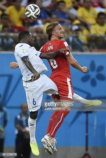 Switzerland's defender Michael Lang jumps to head the ball with Honduras' defender Juan Carlos Garcia during the Group E football match between...