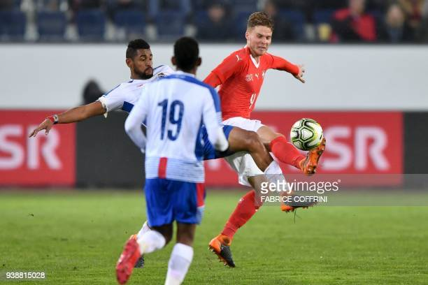 Switzerland's defender Nico Elvedi and Panama's midfielder Anibal Godoy vies for the ball during the international friendly football match between...