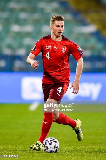 Switzerland's defender Nico Elvedi controls the ball during the FIFA World Cup Qatar 2022 Group C qualification football match between Bulgaria and...