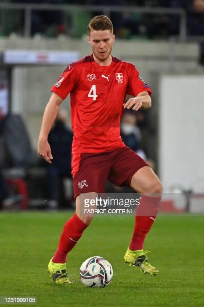 Switzerland's defender Nico Elvedi controls the ball during the FIFA World Cup Qatar 2022 Group C qualification football match between Switzerland...