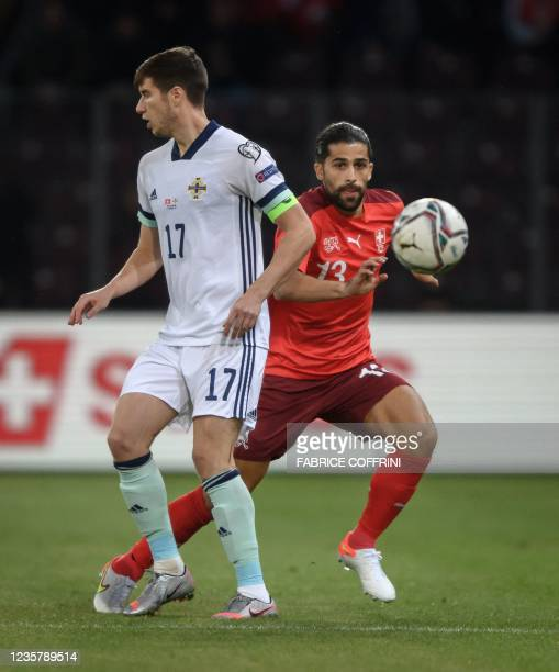 Switzerland's defender Ricardo Rodriguez and Northern Ireland's midfielder Patrick McNair fight for the ball during the FIFA World Cup 2022 Group C...