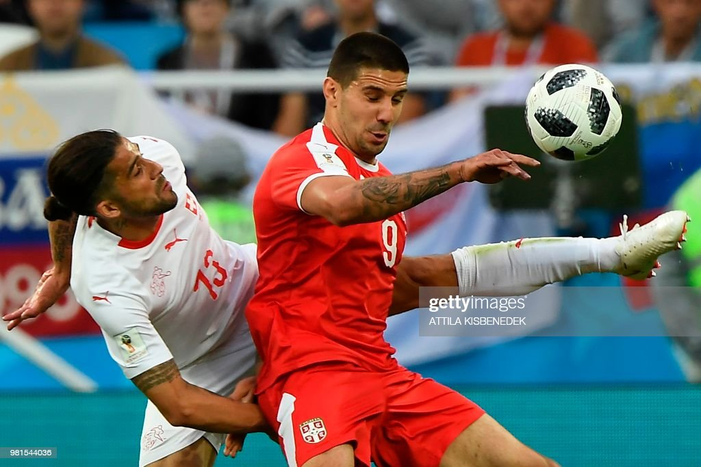 TOPSHOT - Switzerland's defender Ricardo Rodriguez (L) and Serbia's forward Aleksandar Mitrovic fight for the ball during their Russia 2018 World Cup Group E football match between Serbia and Switzerland at the Kaliningrad Stadium in Kaliningrad on June 22, 2018. (Photo by Attila KISBENEDEK / AFP) / RESTRICTED