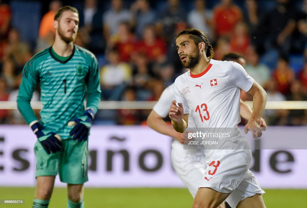 Switzerland's defender Ricardo Rodriguez (R) celebrates a goal beside Spain's goalkeeper David de Gea during the international friendly football match between Spain and Switzerland at La Ceramica stadium in Vila-real on June 3, 2018.