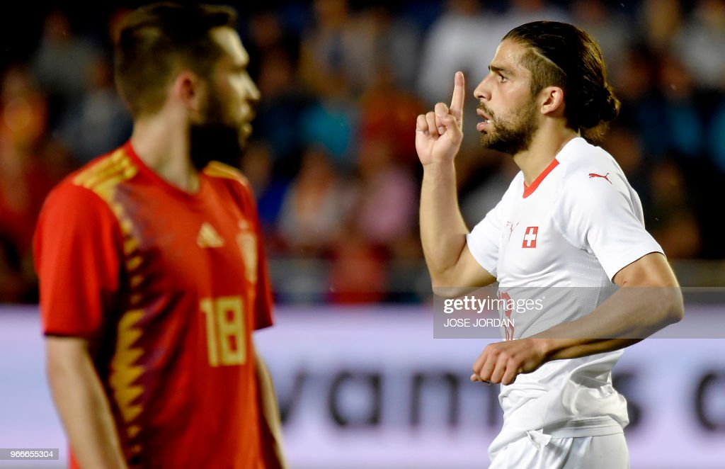 Switzerland's defender Ricardo Rodriguez (R) celebrates a goal during the international friendly football match between Spain and Switzerland at La Ceramica stadium in Vila-real on June 3, 2018.