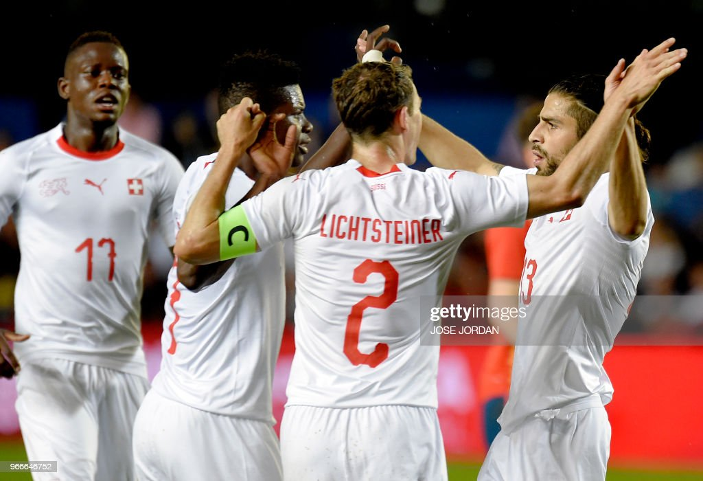 Switzerland's defender Ricardo Rodriguez (R) celebrates a goal with teammates during the international friendly football match between Spain and Switzerland at La Ceramica stadium in Vila-real on June 3, 2018.