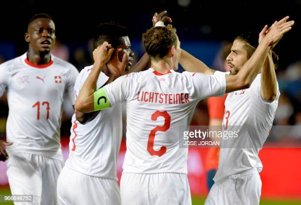 Switzerland's defender Ricardo Rodriguez celebrates a goal with teammates during the international friendly football match between Spain and...