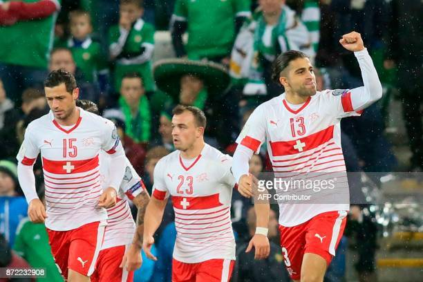 Switzerland's defender Ricardo Rodriguez celebrates scoring the opening goal from the penalty spot during the FIFA 2018 World Cup qualifier second...