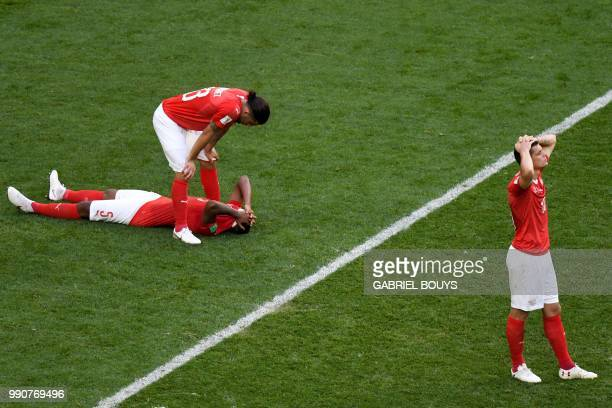Switzerland's defender Ricardo Rodriguez Switzerland's defender Manuel Akanji and Switzerland's forward Mario Gavranovic look dejected at the end of...
