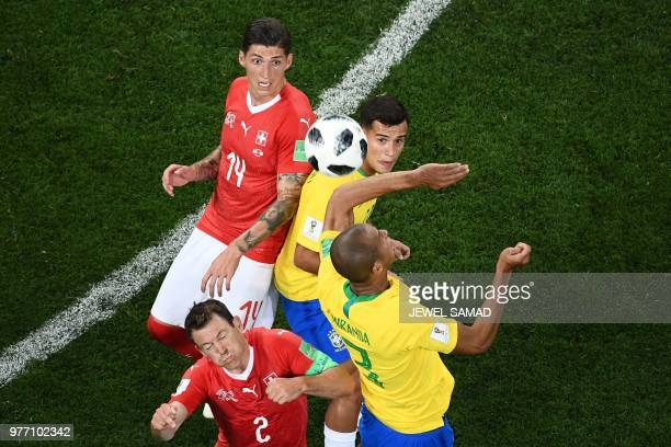 Switzerland's defender Stephan Lichtsteiner and Switzerland's midfielder Steven Zuber fights for the ball with Brazil's midfielder Casemiro and...