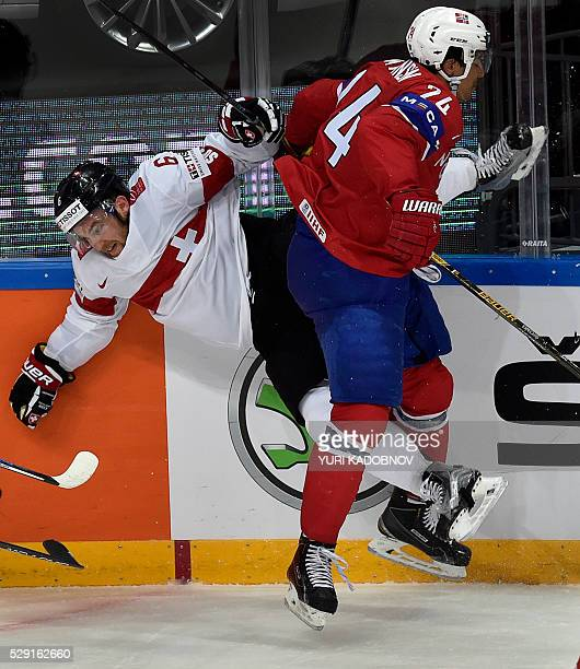 Switzerland's defender Yannick Weber vies with Norway's forward Andreas Martinsen during the group A preliminary round game Norway vs Switzerland at...