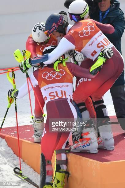 Switzerland's Denise Feierabend Switzerland's Wendy Holdener Switzerland's Daniel Yule and Switzerland's Ramon Zenhaeusern celebrate after winning...
