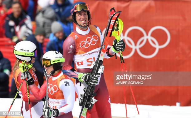 Switzerland's Denise Feierabend Wendy Holdener and Ramon Zenhaeusern celebrate after winning the Alpine Skiing Team Event big final at the Jeongseon...