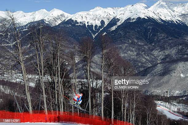 Switzerland's Didier Cuche skis past during the first training session of the Men's World Cup Downhill on February 8 2012 in the Rosa Khutor Mountain...