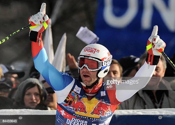 Switzerland's Didier Defago celebrates winning the famous Hahnenkamm downhill during the men's World cup downhill in Kitzbuhel on January 24, 2009....