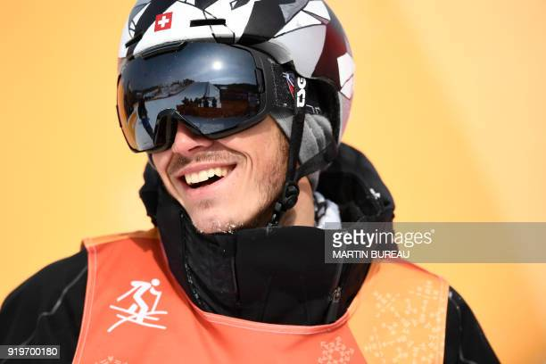 Switzerland's Elias Ambuehl reacts as he competes in a run of the men's ski slopestyle final event during the Pyeongchang 2018 Winter Olympic Games...
