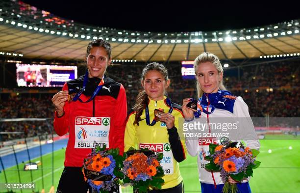 Switzerland's Fabienne Schlumpf Germany's GesaFelicitas Krause and Norway's Karoline Bjerkeli Grovdal celebrate on the podium during the medal...