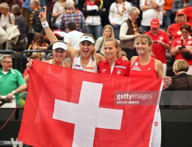 Switzerland's FedCup team including Martina Hingis Belinda Bencic Viktorija Golubic and Timea Bacsinszky celebrate after winning the Fed Cup tennis...