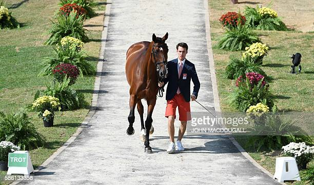 Switzerland's Felix Vogg leads Onfire to a trot during the first horse inspection of the Equestrian's Eventing phase during the 2016 Rio Olympic...