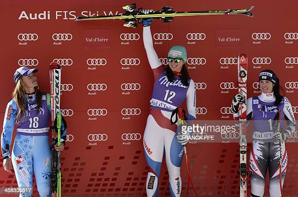 Switzerland's first place winner Marianne KauffmannAbderhalden celebrates on the podium next to Slovenia's Tina Maze and Austria's Cornelia Huetter...