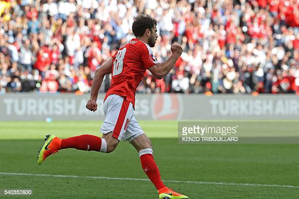 Switzerland's forward Admir Mehmedi celebrates after scoring a goal during the Euro 2016 group A football match between Romania and Switzerland at...